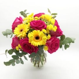 GIALLO LIMONE: rose rosa, gerbere gialle e santini